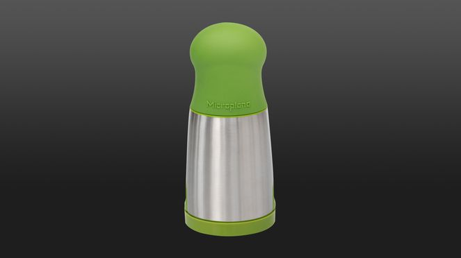 herb mill in modern design with stainless steel and green top