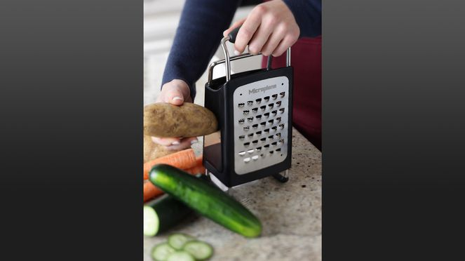 multifunctional grater in use
