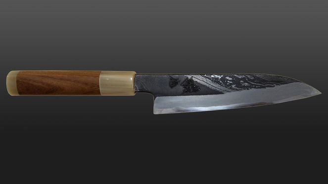 hand-forged damask knife with especially grained blade