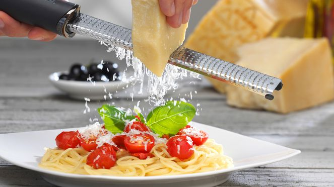 Microplane cheese grater for grating cheese